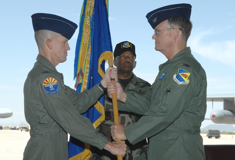 Col. William A. Pollan (right) receives the 355th Medical Group guidon from 355th Fighter Wing Commander Col. Kent Laughbaum during a change-of-command ceremony at the 79th Rescue Squadron hangar here July 13. Colonel Pollan assumed command of the 355th MDG after a yearlong assignment as the deputy commander of the 99th Medical Group at Nellis Air Force Base, Nev. (U.S. Air Force photo/Airman 1st Class Noah R. Johnson)