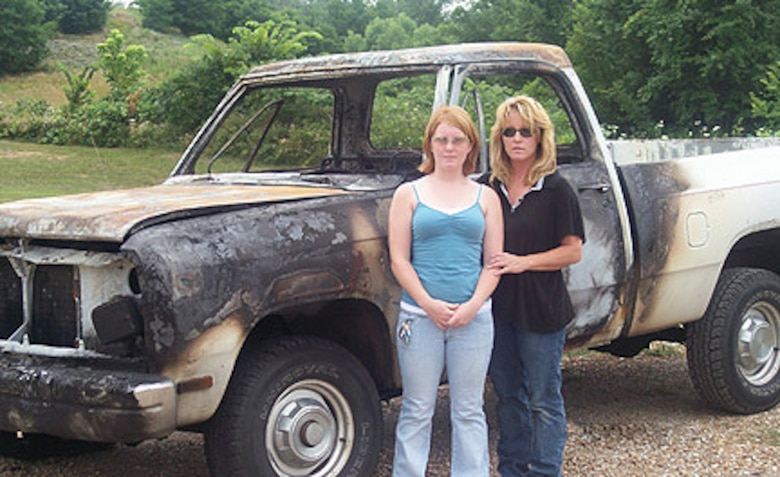 Brooklynn and Susan Wagner stand in front of the burned remains of the 1992 Dodge Ram truck, which belonged to Tech. Sgt. Joe Clark, 509th Aircraft Maintenance Squadron. The two escaped the truck blaze unharmed June 25 in Knob Noster, Mo. (Photo printed with permission of Susan Wagner)