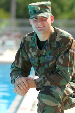 2nd Lt. John Bergmans, 820th Security Forces Group intelligence analyst, recently helped revive a small child who appeared to have drowned at his apartment complex's pool. Lieutenant Bergmans' combined Air Force self-aid and buddy care training with instinctive thinking to remove the water from the child's lungs, helped her begin breathing. (U.S. Air Force photo by Tech. Sgt. Parker Gyokeres)