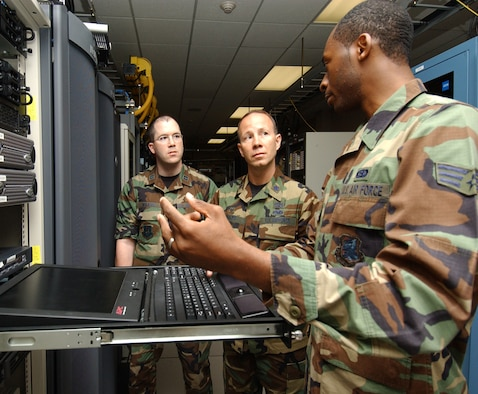 From left, Capt. John Wilkins and  Lt. Col. Ray Adams Jr., new commander of the 81st Communications Squadron, are briefed by Senior Airman Taveres Simpson on the system management server.  Colonel Adams took command July 2.  He comes to Keesler  from Scott Air Force Base, Ill., where he was U.S. Transportation Command's  test and transformation branch chief in the  command, control, communications and computer systems directorate.   (U.S. Air Force photo by Kemberly Groue)