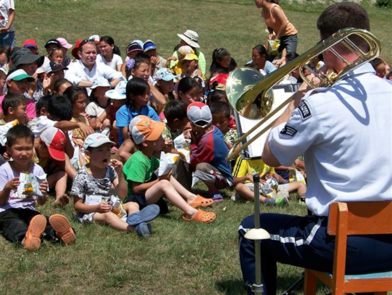 ULAANBATAAR, Mongolia -- The USAF Band of the Pacific-Asia performs at an orphanage July 5. (Courtesy USAF photo)