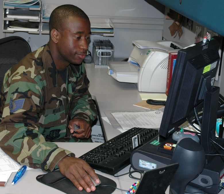 VANDENBERG AIR FORCE BASE, Calif. -- Staff SSgt. Travis Heath reviews physicals to make sure Airmen are fit to serve. The Public Health Flight was able to approve 500 Airmen to deploy around the world in 2006. (U.S. Air Force photo/Airman 1st Class Wesley Carter)