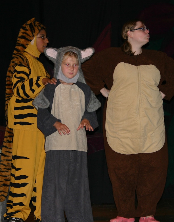 "From left to right: Patricia Romero, Alison Brewer and Chelle Robinson perform a scene from ""The Jungle Book"" during a dress rehearsal. The Missoula Children's Theatre presented the play at the base theater here July 14. (U.S. Air Force photo by Airman Elliott Sprehe)"