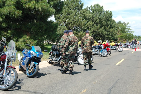 Airmen check out some of the many motorcycles on display July 13 during Peterson's motorcycle rally. There was safety tips, games, music, food and more offered during the event. (U.S. Air Force photo by Corey Dahl)