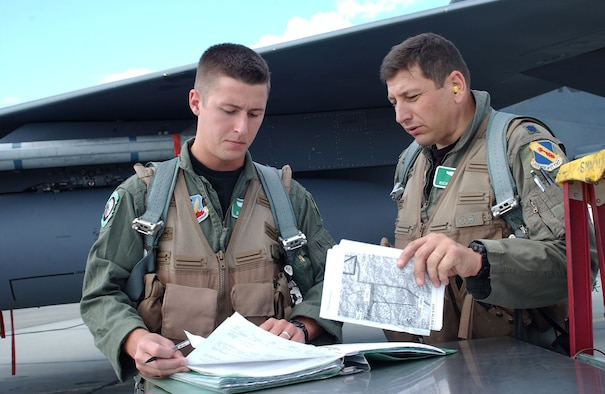 EIELSON AIR FORCE BASE, Alaska -- Lt. Col. Richard Tabasco (R), and Capt Dave Cochran, with the 335th Fighter Squadron, Seymour Johnson, N.C., prepare for an allied flight with Turkish and Spanish aviators at Red Flag Alaska July 16, 2007.  This exercise provides unique opportunities to help integrate various forces into joint, coalition, and bilateral training from simulated forward operating bases.  (U.S. Air Force photo by Capt. Tana R.H. Stevenson)