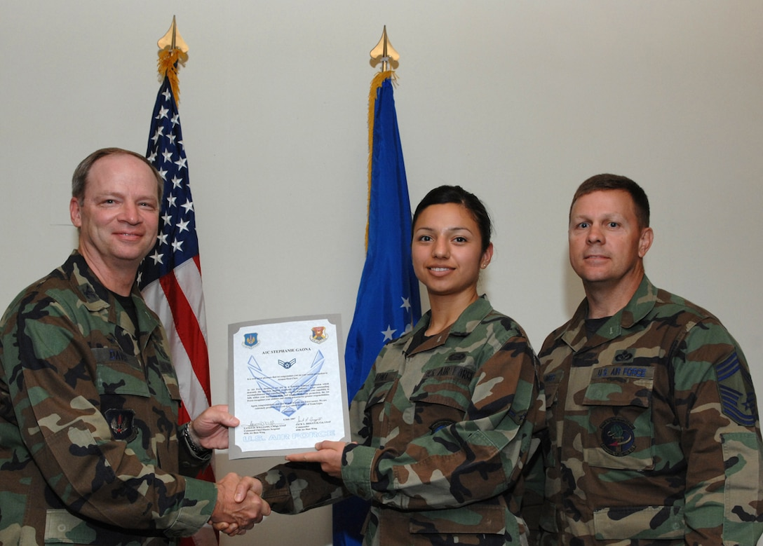 LAJES FIELD, Azores, Portugal – Airman 1st Class Stephanie Gaona, 65th Mission Support Squadron, is congratulated by Col. Mark Davis, 65th Mission Support Group commander, and Chief Master Sgt. Chief Master Gary Coumbs, 65th Civil Engineer Squadron superintendent, on her promotion during the Wing Recognition Ceremony in the Top of the Rock here July 6, 2007. (U.S. Air Force photo by Guido Melo)