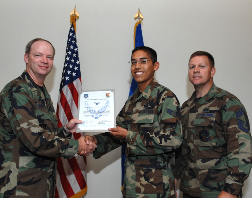 LAJES FIELD, Azores, Portugal – Airman 1st Class Eduardo Gonzalez, 65th Communications Squadron, is congratulated by Col. Mark Davis, 65th Mission Support Group commander, and Chief Master Sgt. Chief Master Gary Coumbs, 65th Civil Engineer Squadron superintendent, on his promotion during the Wing Recognition Ceremony in the Top of the Rock here July 6, 2007. (U.S. Air Force photo by Guido Melo)