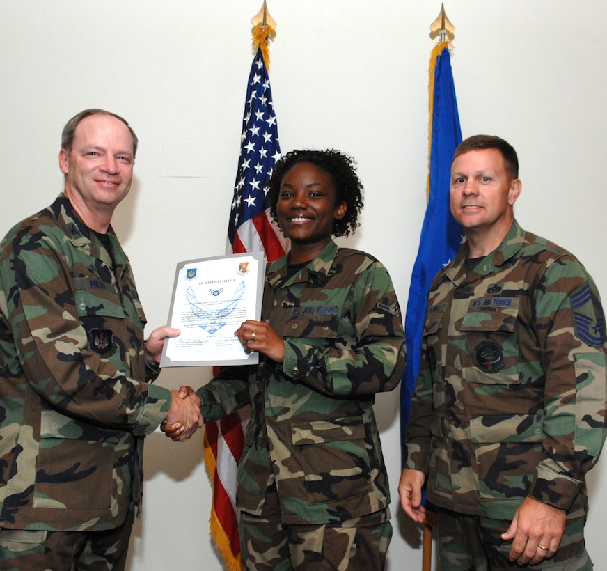 LAJES FIELD, Azores, Portugal – Airman 1st Class Keyona Little, 65th Communications Squadron, is congratulated by Col. Mark Davis, 65th Mission Support Group commander, and Chief Master Sgt. Chief Master Gary Coumbs, 65th Civil Engineer Squadron superintendent, on her promotion during the Wing Recognition Ceremony in the Top of the Rock here July 6, 2007. (U.S. Air Force photo by Guido Melo)