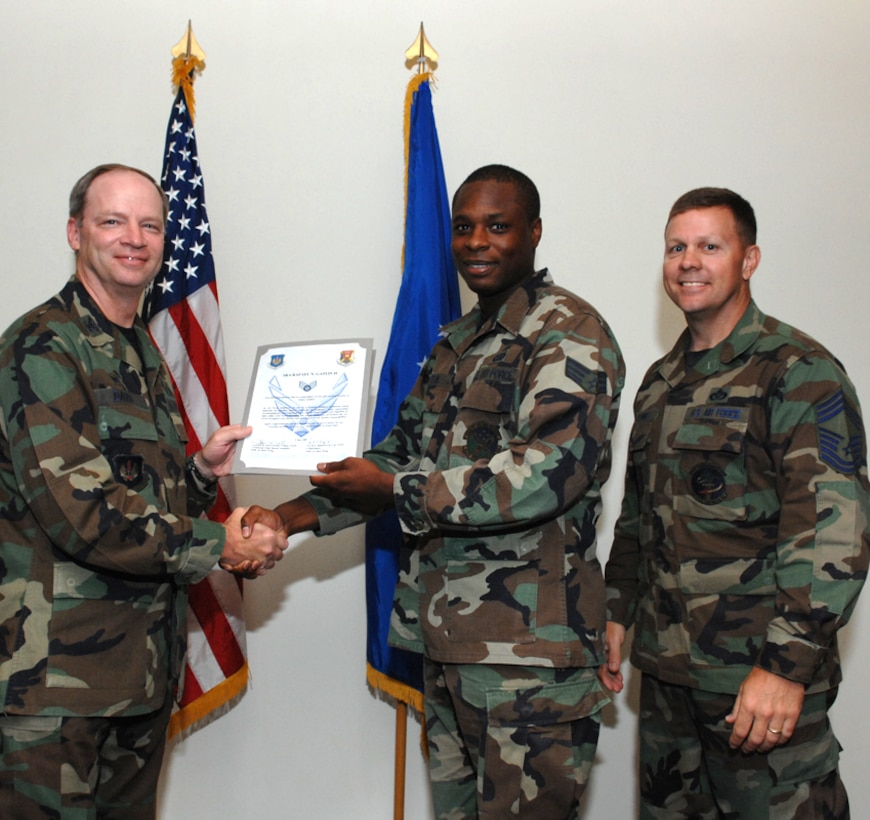 LAJES FIELD, Azores, Portugal – Senior Airman Rafael Gatlin, 65th Civil Engineer Squadron, is congratulated by Col. Mark Davis, 65th Mission Support Group commander, and Chief Master Sgt. Chief Master Gary Coumbs, 65th Civil Engineer Squadron superintendent, on his promotion during the Wing Recognition Ceremony in the Top of the Rock here July 6, 2007. (U.S. Air Force photo by Guido Melo)