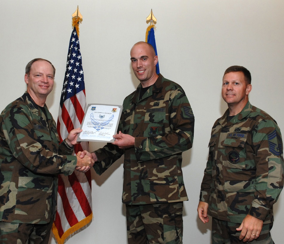 LAJES FIELD, Azores, Portugal – Tech. Sgt. Joshua Franklin, 65th Air Base Wing, is congratulated by Col. Mark Davis, 65th Mission Support Group commander, and Chief Master Sgt. Chief Master Gary Coumbs, 65th Civil Engineer Squadron superintendent, on his promotion during the Wing Recognition Ceremony in the Top of the Rock here July 6, 2007. (U.S. Air Force photo by Guido Melo)