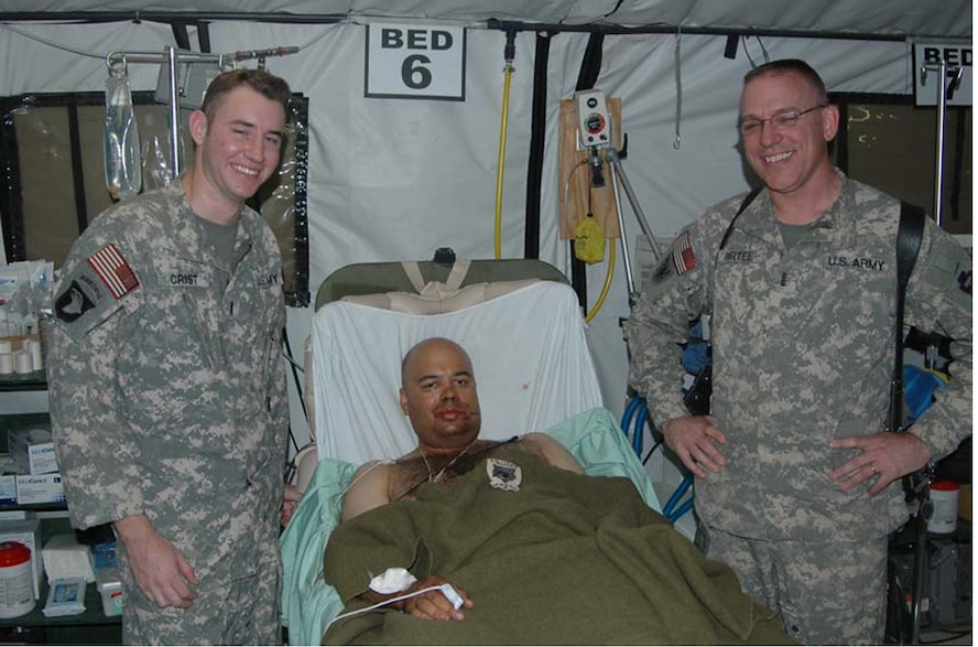 LSA ANACONDA, Iraq -- Chief Warrant Officer 2 Allen Crist (left) and Chief Warrant Officer 4 Kevin Purtee, check on the medical condition of Spc. Jeffrey Jamaleldine following a harrowing mission to evacuate the wounded Soldier. (U.S. Army photo/Maj. Gregory O'Connor)