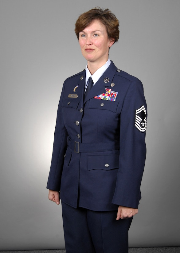 Senior Master Sgt. Dana Athnos models the new Air Force service dress Heritage Coat, designed on the uniform worn by Gen. Hap Arnold. The Air Force launches a fit test this fall with an actual 90-day wear test in the spring of 2008. According to Air Force leaders, the Heritage Coat will give the service a more military look that reflects the warrior ethos Airmen have today. (U.S. Air Force photo/Tech. Sgt. Cohen Young)