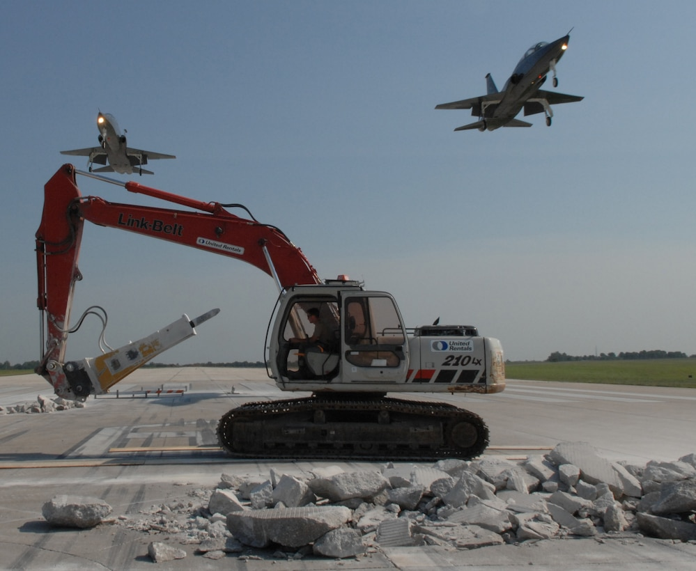 WHITEMAN AIR FORCE BASE, Mo. -- Members of the 823rd RED HORSE Squadron continue to repair runway 19 as two T-38 Talons fly overhead. (U.S. Air Force photo/Staff Sgt. Jason Barebo)