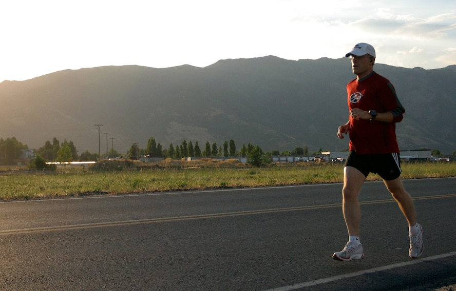 """Capt. Harrison in a five mile run before his second marathon event in the """"Grand Slam,"""" a four-marathon event that takes place over five months.  """"Some wouldn't think running is relaxing, but to me it is,"""" said Captain Harrison. (U.S. Air Force Photo by Senior Airman Daniel Durbin)"""