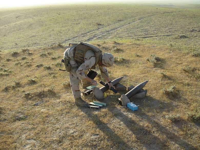 Staff Sgt. Kenneth Roads, formerly of Peterson's Explosive Ordinance Detachment, destroys rockets on a timer pointed at Bagram. Most members of the Peterson unit have deployed to Iraq and Afghanistan, where they've helped dismantle IEDs and landmines. (U.S. Air Force photo)