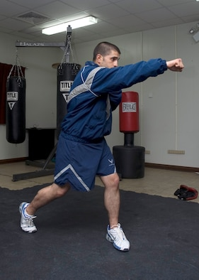 SOUTHWEST ASIA -- Airman 1st Class Zachary Christy, 386th Services Squadron services specialist, practices boxing techniques at a deployed location. Airman Christy teaches boxing classes six days a week, helping his fellow Airmen stay fit while deployed. He is deployed here from Ellsworth Air Force Base, S. D., where he expects to return in September.