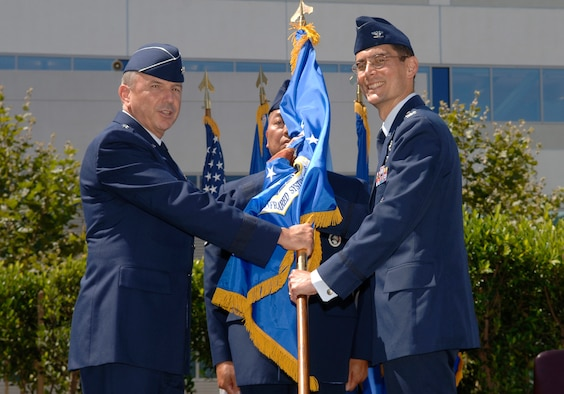 Colonel John Amrine assumes command of SMC's Space Based Infrared Systems Wing, July 19. The coloenl has been the vice commander of the SBIRS Wing since May 2006.  Prior to this current assignment, he was the Commander, Undersecretary of the Air Force (Space) Operations Group at Buckley AFB, Colo. (Photo by Paul Testerman)
