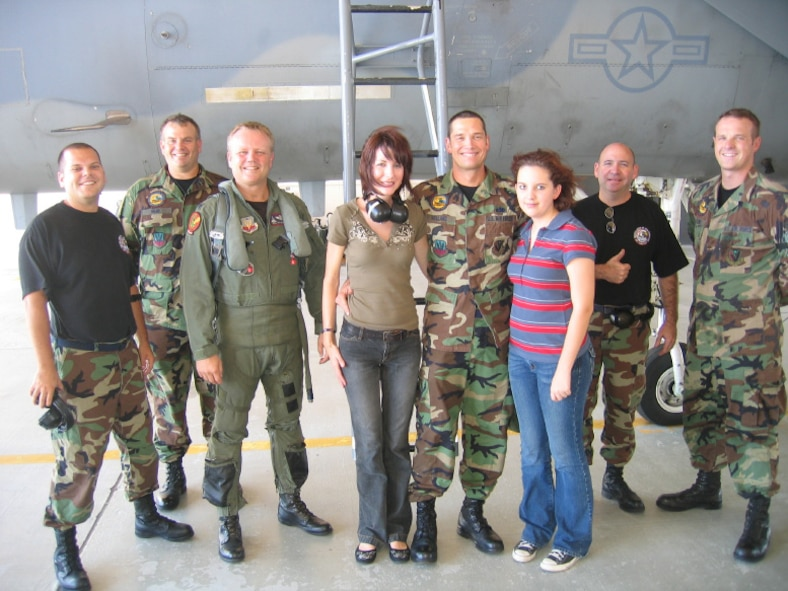 "Members of Detachment 1, 125th Fighter Wing alert team gather around Technical Sgt. Gary ""Hollywood"" Holland after this reenlistment ceremony.  Pictured L-R are:  Staff Sgt. Mike Moleta, Senior Master Sgt. Aubrey ""Junior"" Shaw, Lieutenant Col. Birkeland, (wife) Shelley Holland, Technical Sgt. Holland, (daughter) Christian Holland, Master Sgt. Brad Harvey and Senior Airman Marcus Holling.  (USAF photo/Major Cory W. ""Trap"" Bower)"