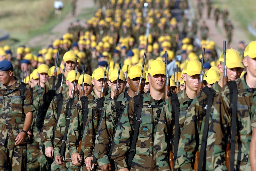 Basic cadet trainees march to Jacks Valley at the U.S. Air Force Academy, Colo. to begin two weeks of training that will test their stamina and determination.  Included will be weapons training, confidence and assault training, drill evaluations, tent inspections and aerobic and physical fitness tests.  (U.S. Air Force photo/Danny Meyer)