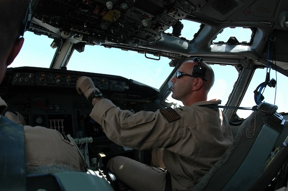Navy Lt j.g. Nathan Lassas, Task Force 124, enters information into the autopilot computer. Lieutenant Lassas pilots an E-6B Mercury over Iraq which helps Soldiers communicate on the ground. (Photo by Staff Sgt. Cassandra Locke)