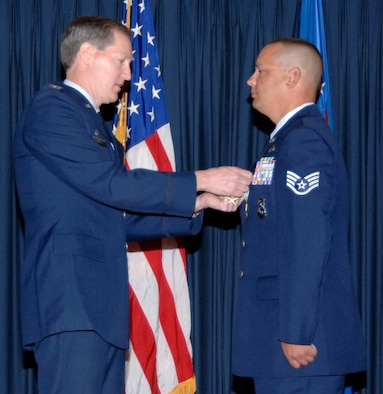 MOUNTAIN HOME AIR FORCE BASE, Idaho -- Staff Sergeant Jason A. Kimberling with the 366th Security Forces Squadron was awarded a Bronze Star Medal with valor and an Army Commendation Medal by Mission Support Group commander Col. Thomas Laffey here July 19 for his actions Aug. 8, 2006 in Qalat Province, Afghanistan. Sergeant Kimberling was one of only three Americans in a Coalition tasking with the Afghan National Police and Army that was attacked. His actions prevented the entire Coalition from being split up during an ambush. (U.S. Air Force Photo/ Airman 1st Class Stephany D. Miller)