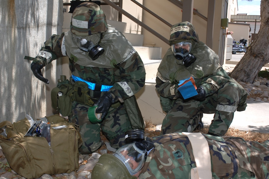 Staff Sgt. Phillip Farrior and Tech. Sgt. Jamie Boyer carry out a post-attack-reconaissance-sweep measures during an operational readiness exercise July 17. OREs help keep Airmen familiar with procedures they will need to know in a deployed environment. (U.S. Air Force photo by Alex R. Lloyd)