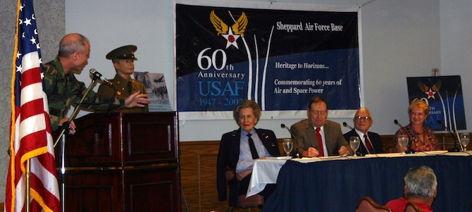 Brig. Gen. Richard Devereaux, 82nd Training Wing commander, speaks on the panel guests at the Lunch-n-Learn at the Sheppard Club July 19.  The panel guests are, from left: former WASP Marion Stegeman-Hodgson, retired Col. Jerry Hawkins, retired Maj. Wayne Kuschel and former WAF Pat Gonzalez of the 82nd TRW. (U.S. Air Force photo/Staff Sgt. Tonnette Thompson)