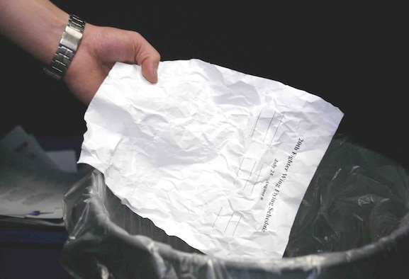 Practicing good operations security by shredding paperwork when no longer needed ensures control of critical information. Throwing away sensitive information could result in it ending up in the wrong hands. (U.S. Air Force photo illustration/Senior Airman John Gordinier)