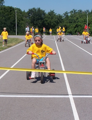 "WHITEMAN AIR FORCE BASE, Mo. -- Julia Hale nears the finish line during the inaugural Whiteman Youth Track and Field Meet July 14. There were 47 youth, ranging in ages from 5 to 15-years-old who participated in 14 events. ""This is the first year we have held a track and field meet for the youth here,"" said Mike Orrison, 509th Services Squadron sports and fitness director. ""The event was run by many volunteers from different squadrons on base."" The highlight of the meet was the youth versus the parents in a 4-by-110-yard tricycle race, Mr. Orrison said. (Photo printed with permission of Michael Orrison)"
