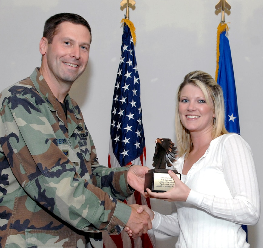 LAJES FIELD, Azores, Portugal – Amber Schindele, 65th Mission Support Group, is congratulated by Col. Jeff Derrick, 65th Air Base Wing vice commander, on being selected as the Category I, U.S. Civilian of the Quarter for April to June 2007 during the Quarterly Awards Ceremony in the Top of the Rock Club here July 18, 2007. (U.S. Air Force photo by Guido Melo)