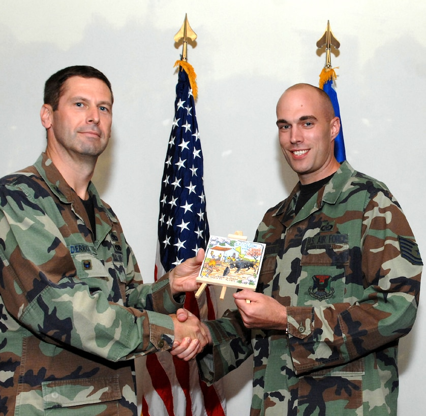 LAJES FIELD, Azores, Portugal – Tech. Sgt. Joshua Franklin, 65th Air Base Wing, is congratulated by Col. Jeff Derrick, 65th ABW vice commander, on being selected as the Military Member Volunteer of the Quarter for April to June 2007 during the Quarterly Awards Ceremony in the Top of the Rock Club here July 18, 2007. (U.S. Air Force photo by Guido Melo)