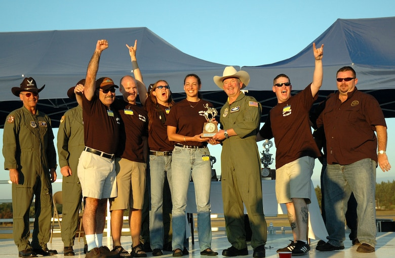 Reservists from McChord's 446th Aeromedical Evacuation Squadron receive the best aeromedical evacuation team award at the Air Mobility Command's Rodeo 2007. The five-member team showed off its skills July 23- 25 in static configurations on both a KC-135 and C-17, a contingency flight, and a challenge course to win the award. (U.S. Air Force photo/Senior Airman Desiree Kiliz)