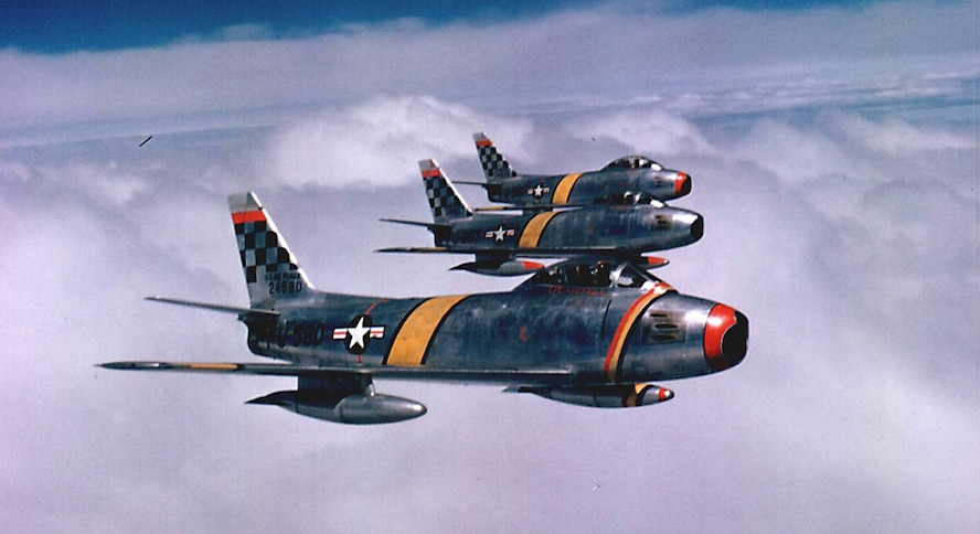 Col. Benjamin O. Davis Jr., commander of the 51st Fighter Interceptor Wing, leads a three-ship F-86F Sabre formation during the Korean War in 1954. Col. Davis, a Tuskegee Airman, was one of the first African-American wing commanders. (Courtesy photo)