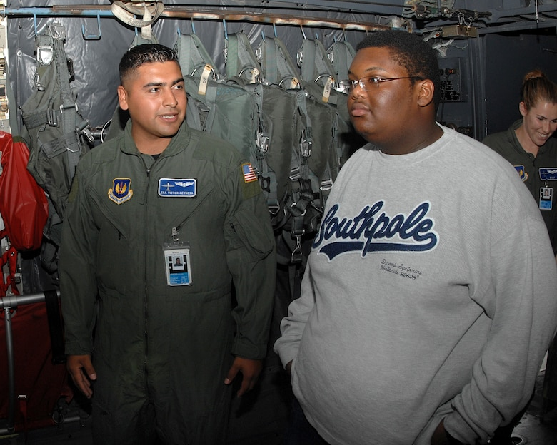 Senior Airman Victor Reynos, 37th Airlift Squadron, shows Jordan Perry all the ins and outs of a C-130 July 21, 2007.  Jordan, who recently beat cancer, had a wish to visit Ramstein Air Base. Jordan's dad, Lester Perry, a retired Army first sergeant, was stationed in Germany in the early 90's. Ramstein Air Base personnel from different squadrons and the Dreams Come True foundation pulled together to make Jordan's dream a reality. (U.S. Air Force Photo/Airman 1st Class Kenny Holston)