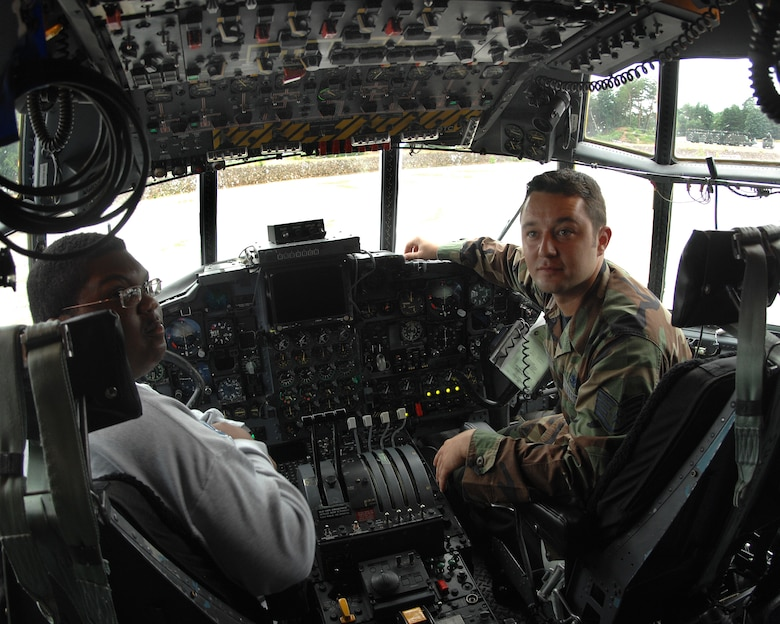 Staff Sgt. Nicholas Sawchak, 86th Aircraft Maintenance Squadron, shows Jordan Perry all the ins and outs of a C-130 July 21, 2007.  Jordan, who recenlty beat cancer, had the wish to visit Ramstein Air Base. Jordan's dad, Lester Perry, a retired first sergeant, was stationed in Germany in the early 90's. Ramstein Air Base personnel from different squadrons and the Dreams Come True foundation pulled together to make Jordan's dream a reality. (U.S. Air Force Photo/A1C Kenny Holston)