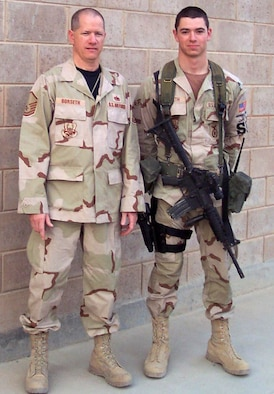 SOUTHWEST ASIA- Master Sgt. Jon Borseth and his son, Airman 1st Class Jon Borseth, II, pose for a photograph after reuniting in May 2007 in Southwest Asia.  Both Sergeant and Airman Borseth deployed to the 386 Air Expeditionary Wing in AEF 7/8.  (U.S. Air Force Photo)