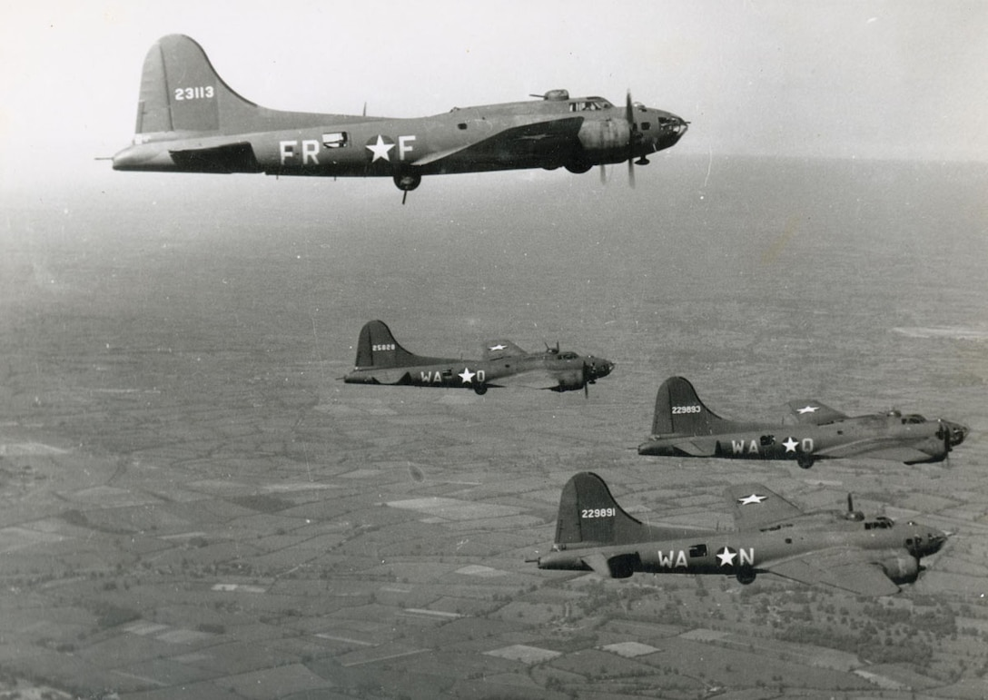 "A formation of B-17 Flying Fortresses from the 379th Bombardment Group (Heavy), 524th and 525th Bombardment Squadrons fly over Europe.  The 379th BG was presented with the ""Grand Slam"" award by 8th Air  Force, for placing first in every evaluated phase of bombing, including best bombing results, greatest tonnage of bombs dropped and lowest losses of aircraft. (U.S. Air Force photo)"