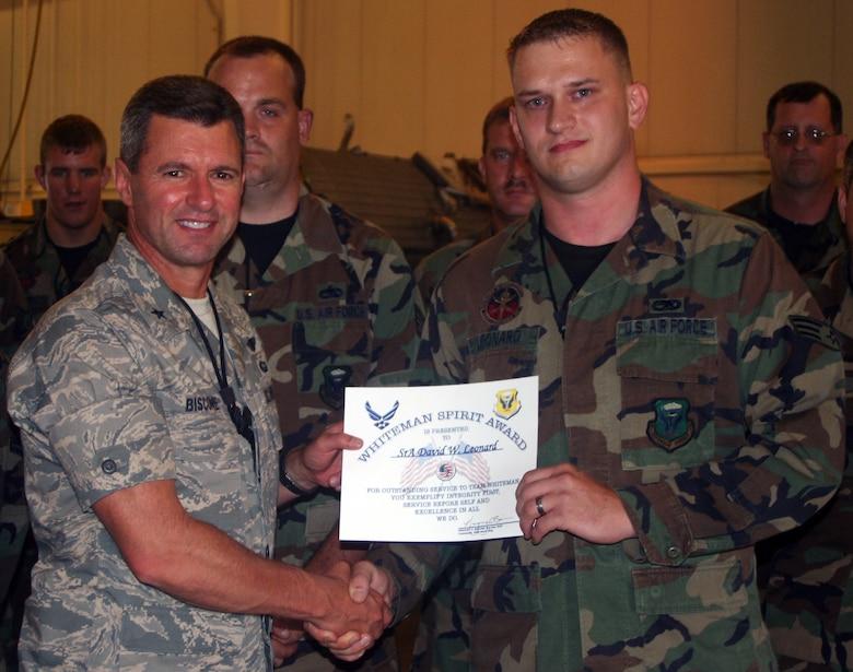 WHITEMAN AIR FORCE BASE, Mo. -- Left to right: Senior Airman David Leonard, 509th Maintenance Squadron, receives the Whiteman Spirit Award from Brig. Gen. Greg Biscone, 509th Bomb Wing commander, July 30. (U.S. Air Force Maj. Joe DellaVedova)