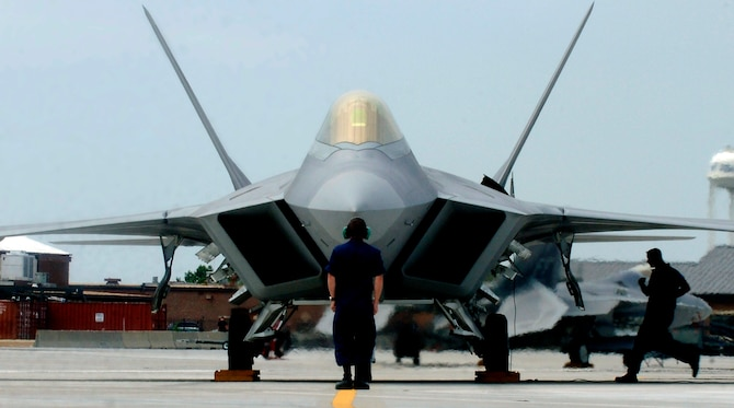"F-22A Raptor Demonstration Team aircraft maintainers prepare to launch out Maj. Paul ""Max"" Moga, the first F-22A Raptor demonstration team pilot, July 13. (U.S. Air Force photo/Senior Airman Christopher L. Ingersoll)"