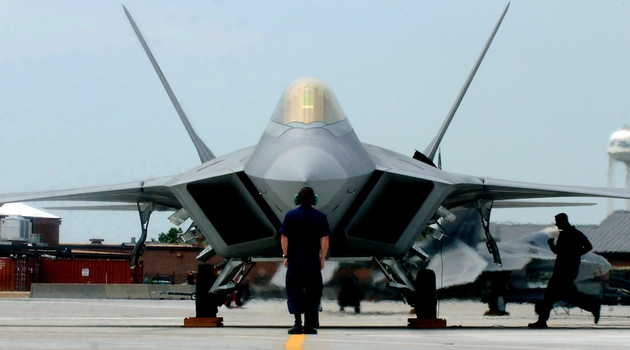 """F-22A Raptor Demonstration Team aircraft maintainers prepare to launch out Maj. Paul """"Max"""" Moga, the first F-22A Raptor demonstration team pilot, July 13. (U.S. Air Force photo/Senior Airman Christopher L. Ingersoll)"""
