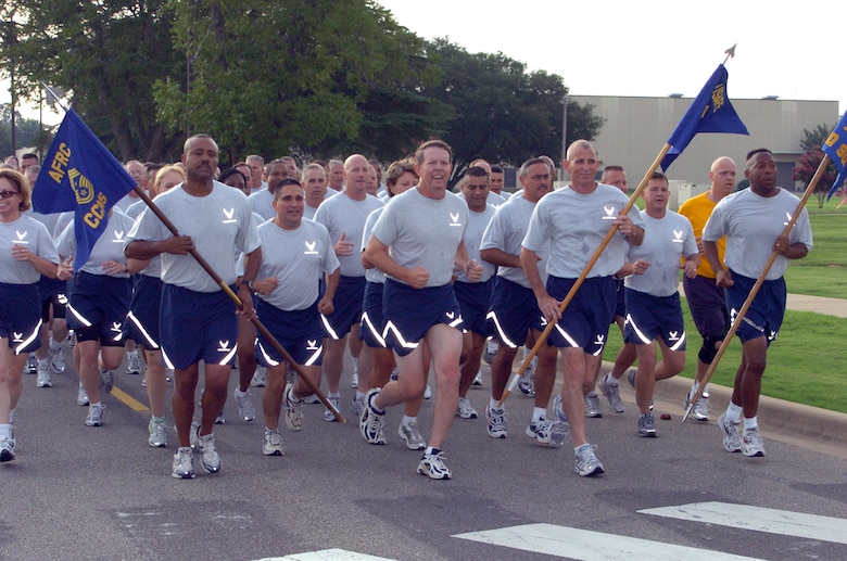"Chief Master Sgt. Lesley Morrissette, 94th Airlift Wing Command Chief (left), proudly bears the guidon of the Air Force Reserve Command's command chief master sergeants while running next to Chief Master Sgt. of the Air Force Rodney J. McKinley during the Senior Enlisted Summit chief's run on July 22, at Maxwell-Gunter Air Force Base, Ala. Chief McKinley and other senior enlisted leaders arrived for the start of the summit held at nearby Gunter Annex, Ala. ""We're eager to begin the summit,"" Chief McKinley said.  ""The Air Force is currently capitalizing on many opportunities and faces several challenges the senior enlisted leaders gathering here are uniquely qualified to address.  I'm looking forward to the information, dialogue and ideas we'll be sharing.""  The summit kicked off July 22 with a day of physical and athletic conditioning and continued through July 27. (U.S. Air Force photo/Master Sgt. Stan Coleman)"