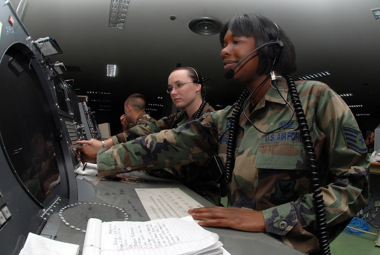 Staff Sgt. Crystal Sheffield, weapons director, and Airman 1st Class Amber Hoedebeck, weapons director technician, 623rd Air Control Flight, on the job at Naha Air Base, Japan. They control the mission by using a Base Air Defense Ground Environment system (BADGE), providing command and control over aircraft with a 360-degree radius. They communicate with pilots, providing time-critical information in order to accomplish the mission. U.S. Air Force/Staff Sgt. Steven Nabor