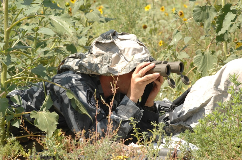 CANNON AIR FORCE BASE, N.M. --A sniper from a Clovis, N.M., Special Weapons and Tactics team takes his position during an Air Force incident management system exercise involving simulated hostage training onJuly 25. The exercise tested situational awareness for both Cannon Air Force Base and the Clovis SWAT team. (U.S. Air Force photo by Airman 1st Class Randi Flaugh)