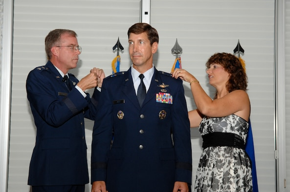 EGLIN AIR FORCE BASE, Fla. -- Maj. Gen. Curtis Bedke, Air Force Flight Test Center commander, Edwards Air Force Base, Calif., and Pam Lanni, pin on the rank of brigadier general on Brig. Gen. Joseph A. Lanni, Air Armament Center vice commander, during a ceremony at the Eglin Officers' Club Aug. 27. More than 300 friends and family members joined the Lanni family to celebrate the achievement. (U.S. Air Force photo by Craig McDonnell)