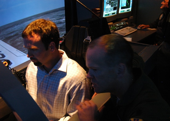 Indianapolis Colts Punter Hunter Smith experiences flying a T-6A Texan II in a simulator with coaching from Lt. Col. Chris Irwin, 559th Flying Training Squadron instructor pilot, during the team's visit to Randolph Air Force Base, Texas, June 1. Coach Dungy, Bill Polian, team president and an Air Force Recruiting Service honorary commander, and Colts players Gary Brackett, Hunter Smith, Bob Sanders, Justin Snow and Adam Vinatieri visited the base to add to their knowledge of the Air Force and share their appreciation for the work of U.S. military servicemembers. (U.S. Air Force photo by Staff Sgt. Jennifer Lindsey)