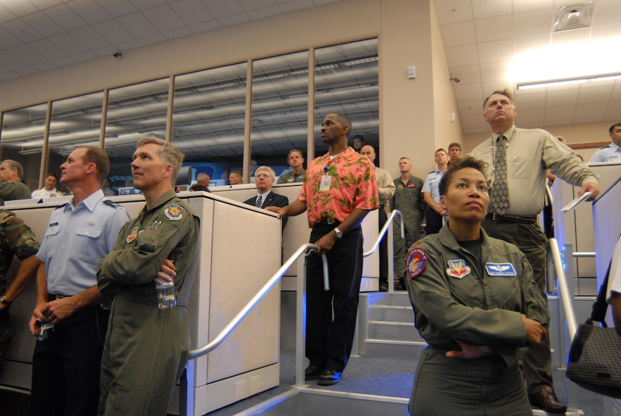 Guests look on as video presentation is displayed on new $3.5 million data wall at dedication of new AFNORTH air and space operations center.