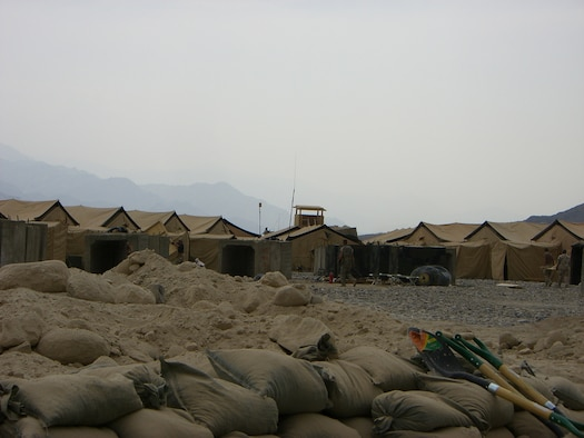 Personnel tents and a defensive observation tower are just beyond the mortar pit of a newly constructed forward operating base miles from Bagram Air Base in Afghanistan. The FOB was built by members of the 56th Civil Engineer Squadron while under enemy attack and austere conditions.  Photo by Tech. Sgt. Steven Goe