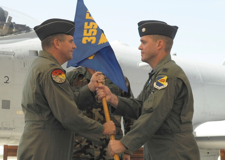 DAVIS-MONTHAN AIR FORCE BASE, Ariz. -- Lt. Col. Francis M. McDonough (right) receives the 355th Operations Support Squadron guidon from 355th Operations Group Commander Col. Mark Koechle during a change-of-command ceremony here May 31. Colonel McDonough, who has accumulated more than 3,600 flying hours, assumed command of the 355th OSS after a one-year tour as chief of the 355th Fighter Wing Inspections, Plans and Programs office here. (U.S. Air Force photo/Senior Airman Christina D. Ponte)