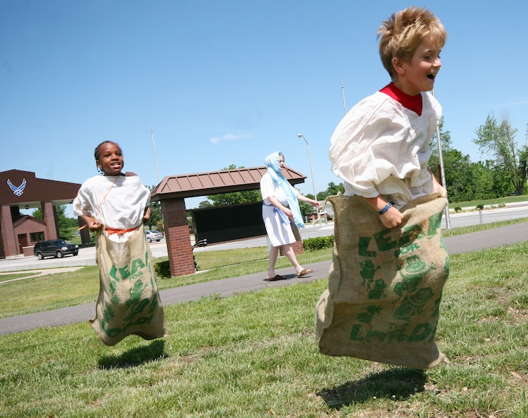 "Terrance Peoples (left) and Luke Rincker, compete in a sack race during the Whiteman Chapel's Vacation Bible School, ""Marketplace 29 A.D."" June 1. (U.S. Air Force photo/Tech. Sgt. Matt Summers.)"