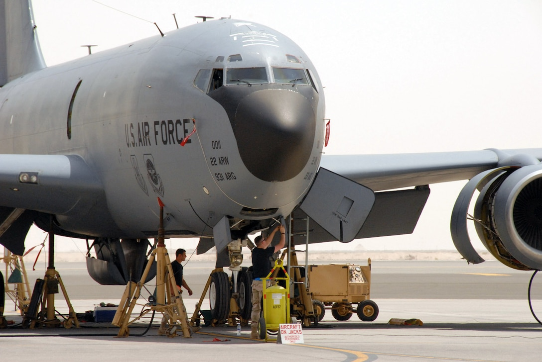 Two maintainers from the 380th Expeditionary Aircraft Maintenance Squadron prepare for a gear retraction operational check on a KC-135 Stratotanker May 30 at a deployed location in Southwest Asia. Coalition tankers off-loaded about 2.8 million pounds of fuel to more than 220 aircraft May 30. (U.S. Air Force photo/Master Sgt. Robert Burgess)